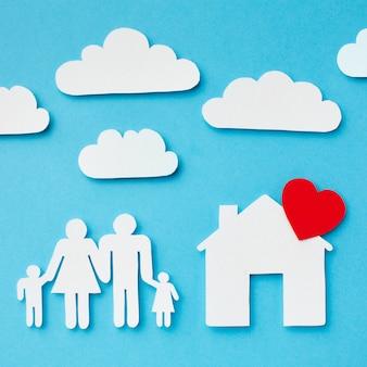Família de corte de papel de close-up e conceito de casa