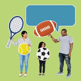 Família feliz com ícones do esporte