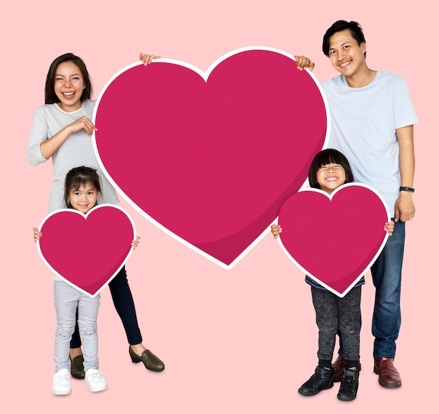 Família feliz, segurando, ícones coração