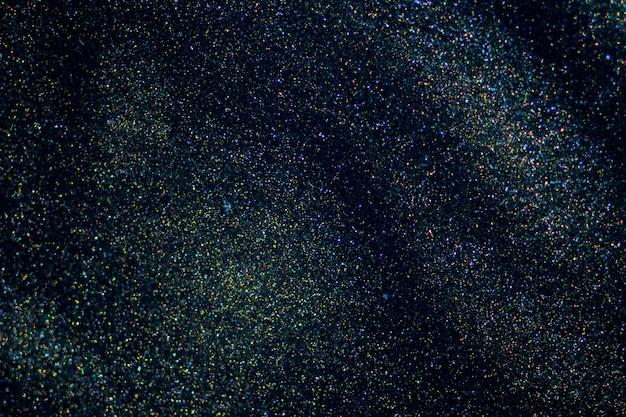 Fantasia bokeh brilho poeira no fundo escuro da magia.