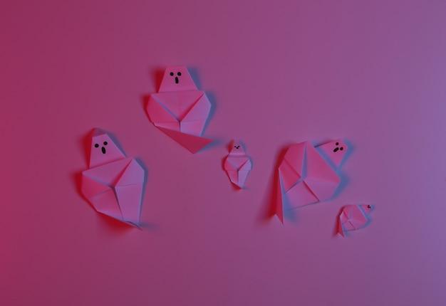 Fantasmas de origami de papel em luz de néon azul vermelha. tema de halloween