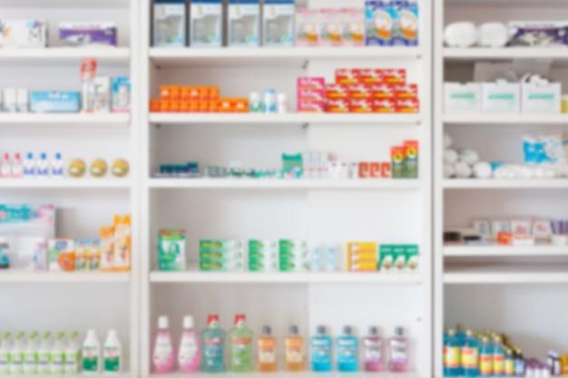 Farmácia, drogaria, desfocagem de fundo abstrato com medicamentos e produtos de saúde nas prateleiras