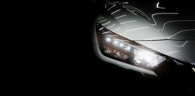 Faróis de carros modernos em fundo preto. copie o espaço