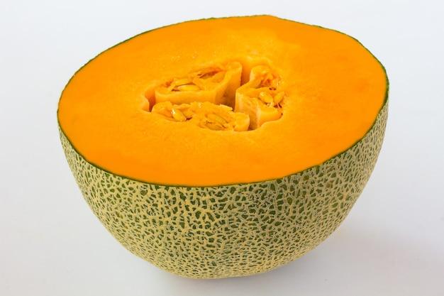 Fatia de abóbora laranja com sementes. vista do topo. fechar-se