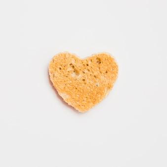 Fatia de pão torrada com forma de coração