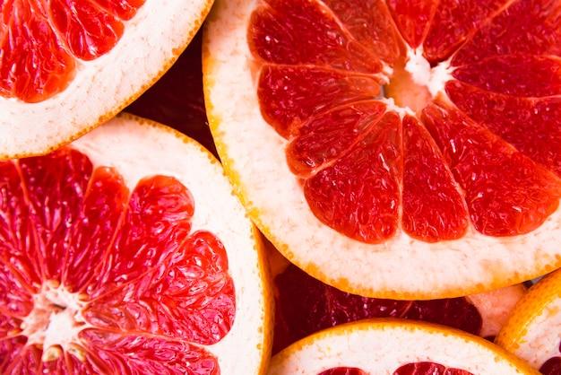 Fatias de close-up de fundo de grapefruit