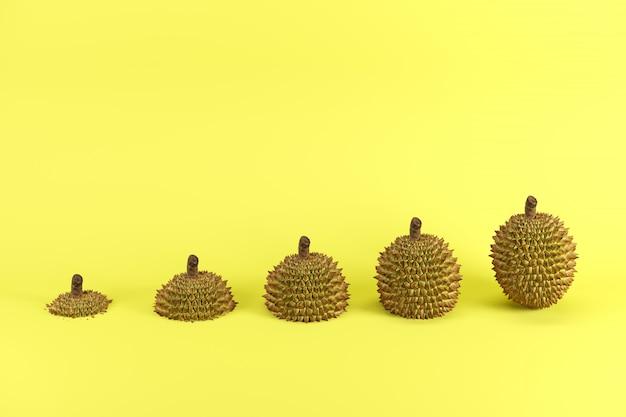 Fatias de durian maduro no conceito mínimo da ideia do fruto do fundo amarelo.