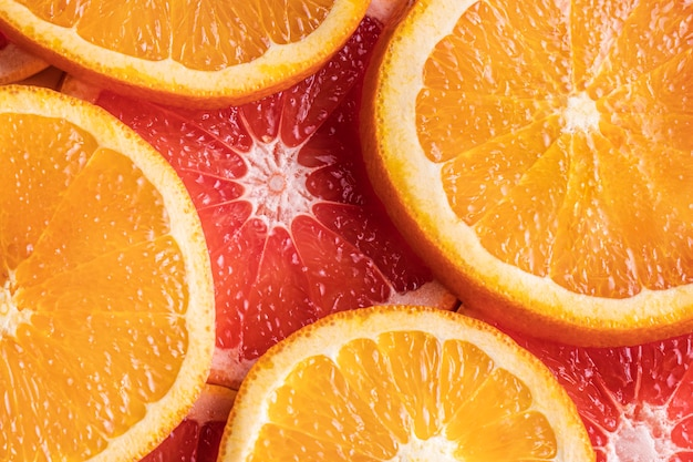 Fatias de laranja e toranja de vista superior