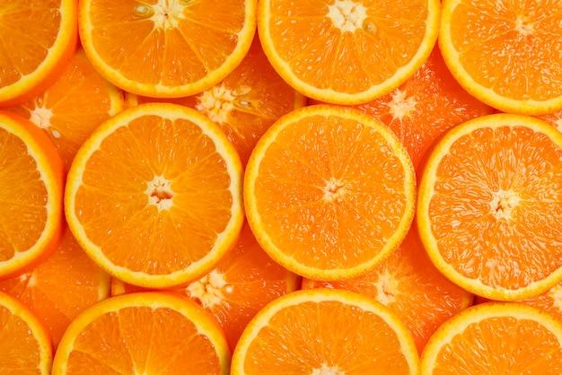 Fatias de laranjas como pano de fundo, vista superior.