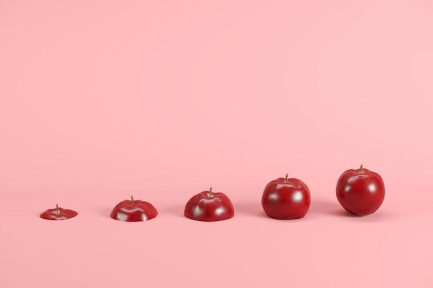 Fatias de maçã fresca, vermelha em fundo rosa