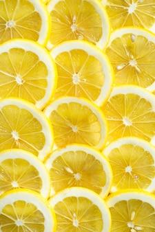 Fatias de padrão de fundo de textura de limão fresco amarelo