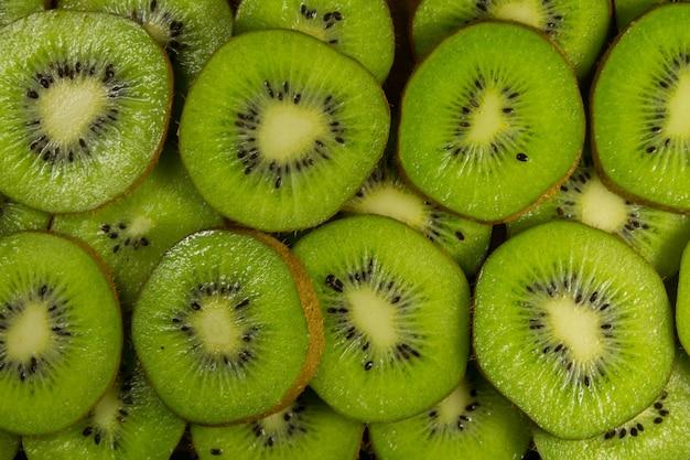 Fatias frescas de kiwi para o fundo