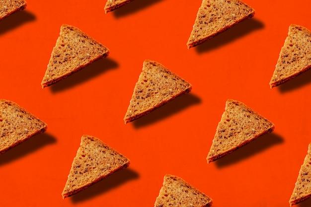 Fatias triangulares de padrão de pão Foto Premium