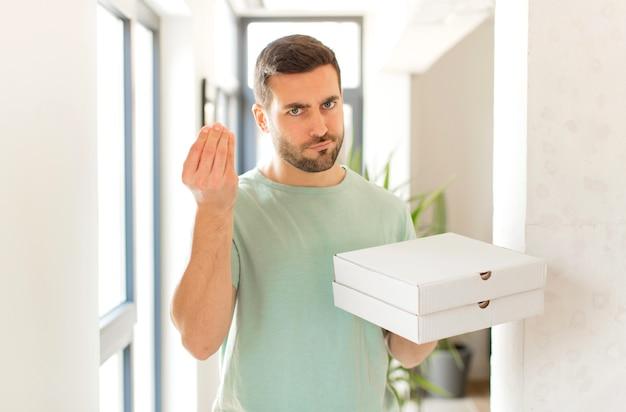 Fazendo capice ou gesto de dinheiro, mandando você pagar suas dívidas!