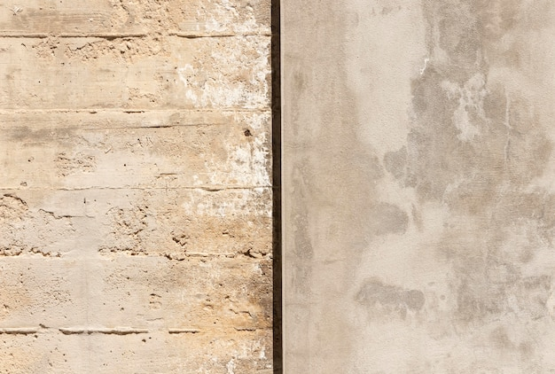 Feche a parede de pedra e concreto