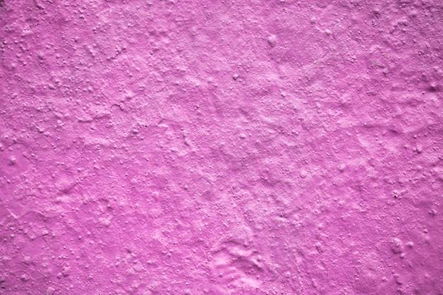 Feche a parede texturizada rosa roxa. textura para o fundo do projeto