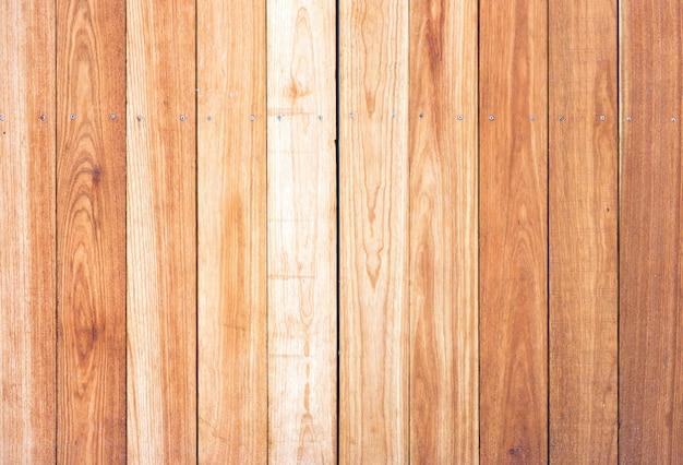 Feche a textura da superfície da madeira alinhada com um nó para o fundo