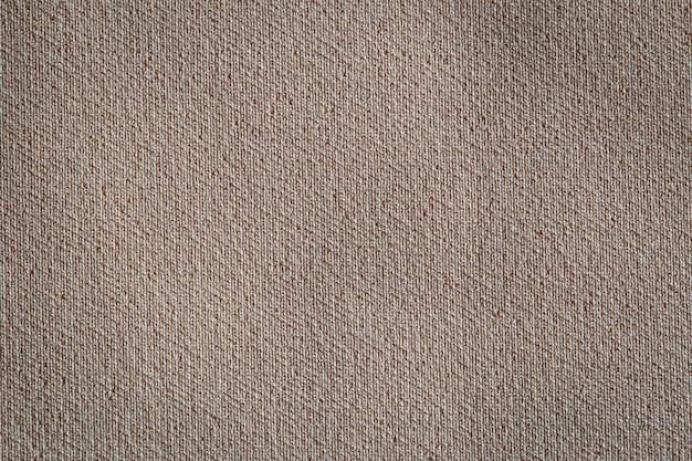 Feche a textura da tela. fundo de têxteis.