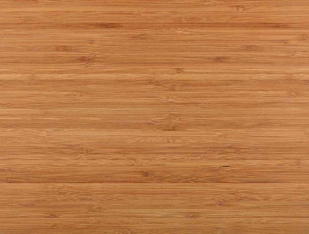 Feche a textura do fundo da superfície da placa de corte de madeira de bambu