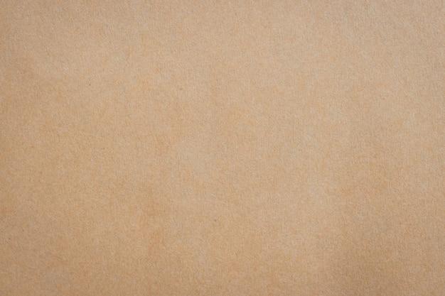 Feche a textura e o fundo do papel marrom com espaço.