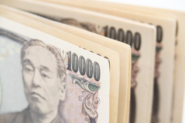 Feche acima da cédula japonesa do dinheiro dos ienes da moeda. economia do japão.