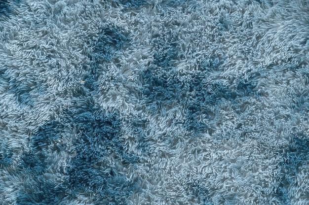 Feche acima da decoração limpa macia da casa do detalhe da textura do tapete do tapete.