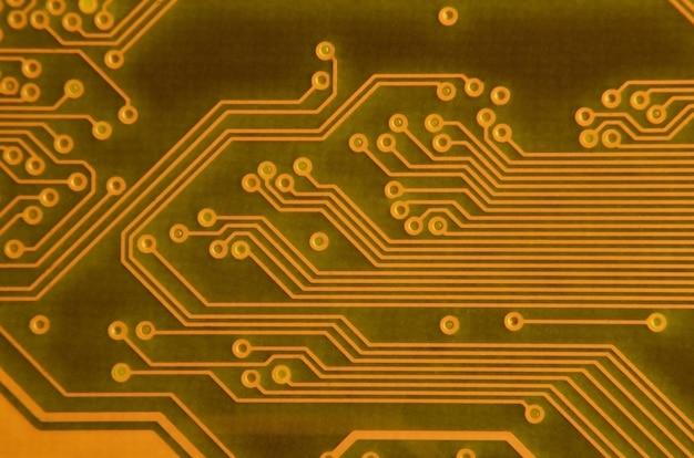 Feche acima da micro placa de circuito colorida. abstratos, tecnologia, fundo
