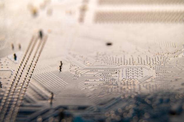 Feche acima da placa de circuito do computador, conceito da indústria informática.