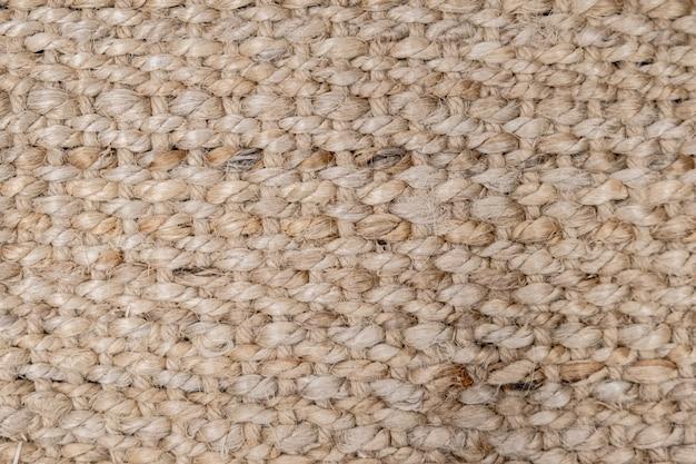 Feche acima da superfície de esteiras de sisal natural, fundo de textura