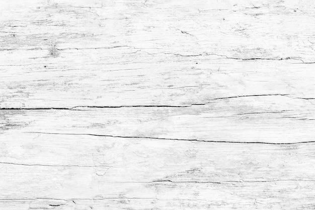 Feche acima da superfície de madeira rústica da tabela com textura do grunge no estilo do vintage.