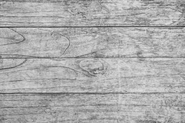 Feche acima da tabela de madeira rústica com textura de superfície da grão no fundo do estilo do vintage.