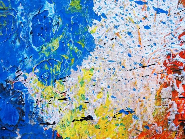 Feche acima da textura colorida do sumário da pintura a óleo da tração da mão.