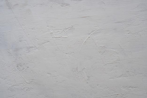 Feche acima da textura da parede cinzenta da madeira compensada.