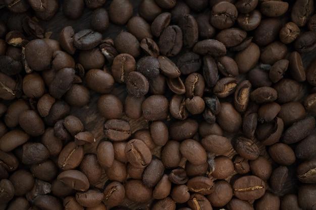 Feche acima da textura do feijão de café, fundo do feijão de café