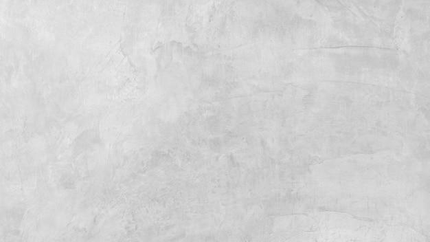Feche acima da textura e do fundo da parede do concreto e do cimento com espaço.