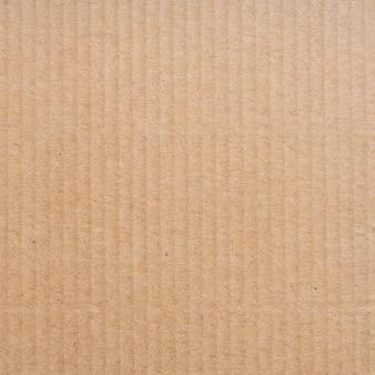 Feche acima da textura e do fundo marrons da caixa de papel do cartão.