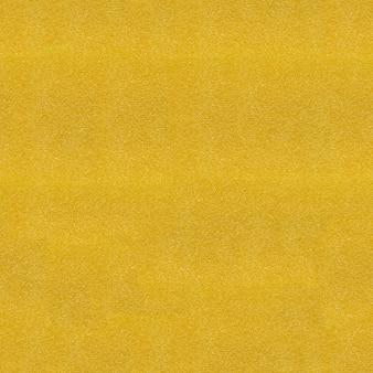 Feche acima da vista na textura amarela da esponja. padrão sem emenda