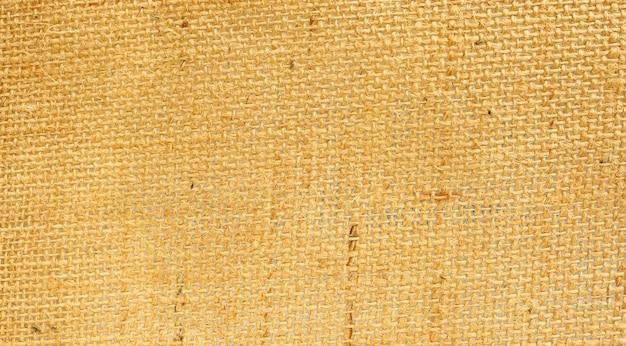 Feche acima de um saco marrom para um fundo abstrato.
