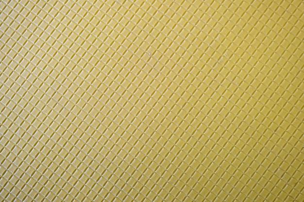 Feche acima do fundo amarelo abstrato com teste padrão geométrico.