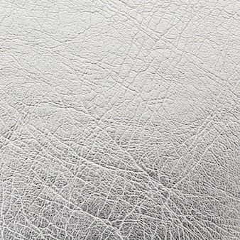 Feche acima do fundo de textura de couro prata