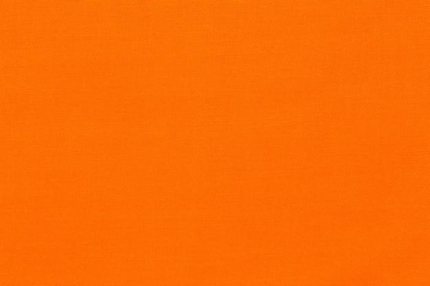Feche de fundo de textura de tecido laranja. alta qualidade