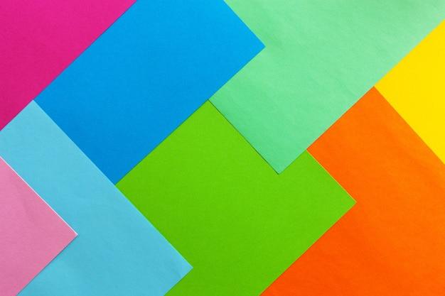 Feche foto de fundo de papel colorido varicoloured. vista de cima, conceito de primavera e vários feriados e eventos