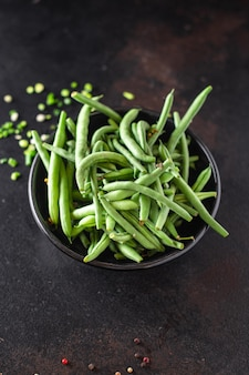 Feijão verde colheita fresca feijão refeição orgânica lanche na mesa cópia espaço comida fundo rústico
