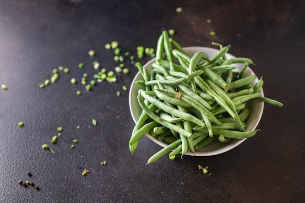 Feijão verde colheita fresca produto orgânico refeição lanche na mesa cópia espaço comida fundo rústico
