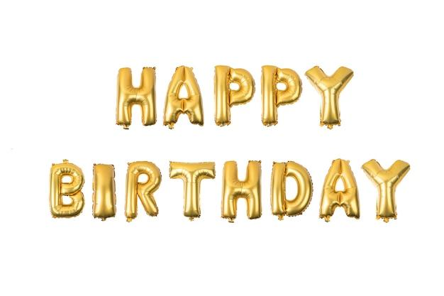 Feliz aniversário alfabeto inglês de balões amarelos (de ouro) sobre um fundo branco