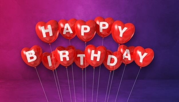 Feliz aniversário vermelho em forma de coração balões de ar em uma cena de superfície roxa