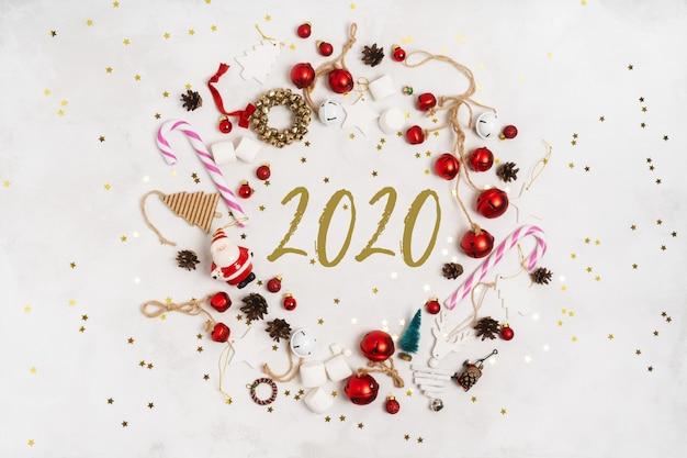 Feliz ano novo 2020 cartão em um quadro redondo