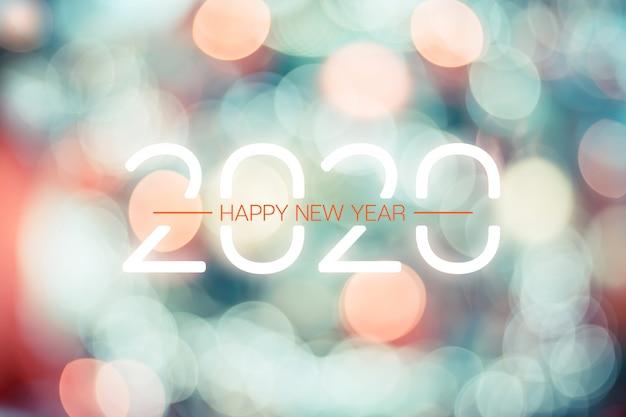 Feliz ano novo 2020 com laranja pastel e luz verde bokeh luz cintilante