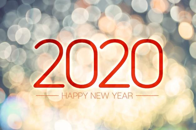 Feliz ano novo 2020 fundo com luzes desfocadas amarelas e azuis
