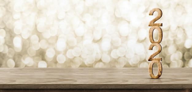 Feliz ano novo 2020 madeira com estrela cintilante na mesa de madeira marrom com fundo dourado bokeh
